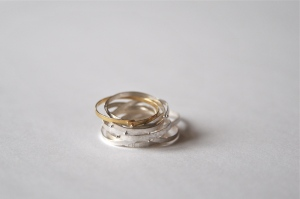 Nine rings in silver and one in gold, all conected to each other. SEK2600.-